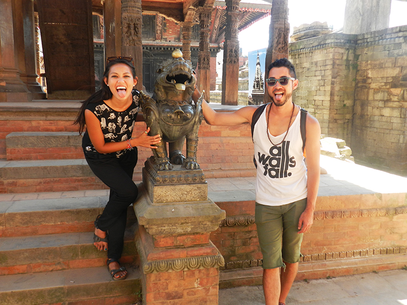 "In Bhaktapur, Nepal's Durbur Square taking my traditional ""pose with a lion statue"" photo"