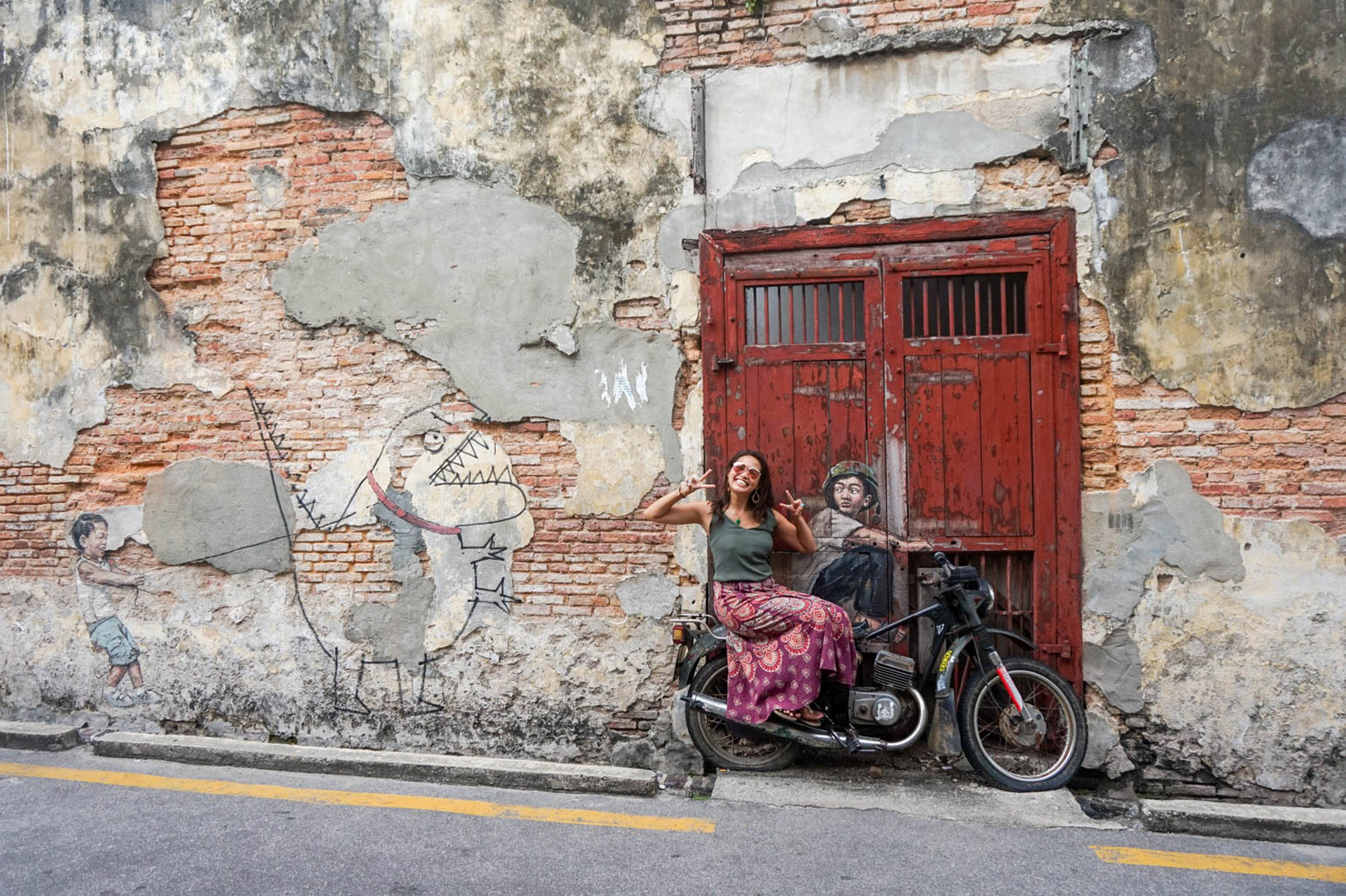 boy on a motorcycle penang street art georgetown