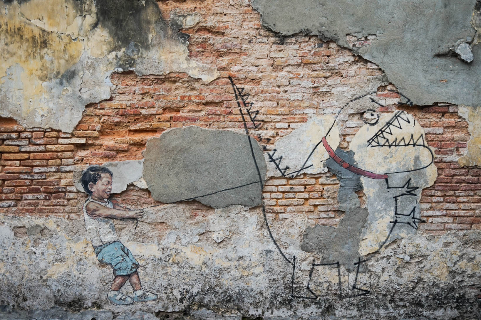 little boy with dino street art penang georgetown