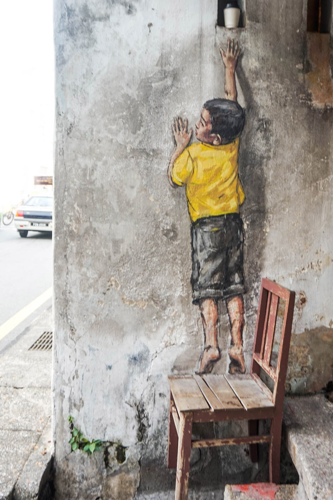 overreaching boy street art penang georgetown